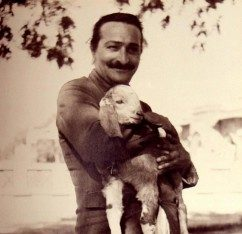 2_Meher_Baba_holding_lamb_blue_bus_tour_1938-242x300